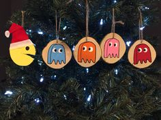 Cut some log slices. Many of them split into a PacMan shape. So I adapted to what I had to work with. Here is lil PacMan Santa. Pac-Man Pac-Dots Christmas Ornaments