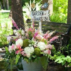 Love this large pink, green and white floral arrangement in a galvanized tub!