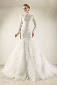 Long sleeve gown. Minus the high collar and minus the mermaid. It needs to be basque waste and full tulle skirt and it will magnificent.