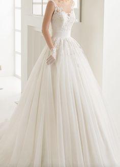 Romantic sleeveless sheer illusion neckline ballgown wedding dress; Featured Dress: Rosa Clará
