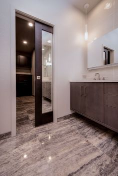 Bathroom remodel with mirrored pocket door by HighCraft Builders.