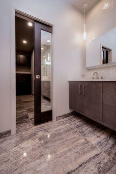 Bathroom Remodel With Mirrored Pocket Door By HighCraft Builders