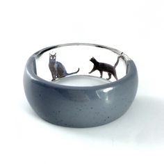 A personal favorite from my Etsy shop https://www.etsy.com/listing/231735316/black-kitty-jewelry-resin-bangle