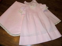 Pink batiste dress, slip, and blanket with hand stitched shadow embroidered initials on blanket...                           Sewn by AuntSchönie