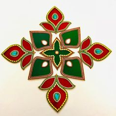 Made with green and red acrylic base, this is a 9 piece rangoli with green and golden beads. When spread out, it is at least 14 inches wide. It can be re arranged in various designs. Spread out size - at least 14 inches Center size - 5 inches Rangoli Borders, Rangoli Border Designs, Rangoli Designs Images, Rangoli Ideas, Rangoli Designs Diwali, Diwali Diy, Diwali Craft, Diwali Decorations At Home, Paper Decorations