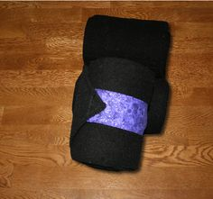 """Black Polos with Purple Galaxy Velcro Straps, $22.00  by KLMequestrian Deck out your horse in style with these black polos made with quality black fleece embellished with purple galaxy fabric on the velcro strap. Made with industrial strength velcro to ensure a proper hold. Two sizes offered: Pony: 2 yards (6ft) long, 4"""" wide Horse: 3 yards (9ft front, 11ft hind) long, 5"""" wide. Four colors offered: Black, Navy, White, or Gray. Set of four."""