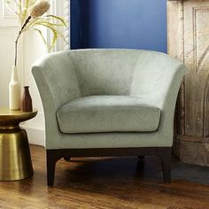 Bought two of these in GREAT condition on Craigslist for $300 for our new house! Yay, Craigslist!! Tulip Chair - Solids #WestElm