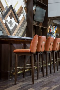 Sheraton Austin at the Capitol | Studio 11 Design | Upholstered Bar Stools. Bar Chairs. Modern Chairs. Restaurant Interior. #restaurantinteriors #barchair #barstool Read more: https://www.brabbu.com/en/inspiration-and-ideas/world-travel/sophisticated-upholstered-bar-stools-want