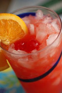 Bahama Mama.  Ingredients:  1 part orange juice  1 part pineapple juice  1 part coconut rum  1/2 part grenadine  Sliced oranges and cherries for garnish.    Directions:  Fill your glass with crushed ice. In a separate pitcher, mix orange juice, pineapple juice, coconut rum, and grenadine. Stir well. Pour over ice. Add orange slices and cherries as garnish.