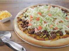 Garth's Taco Pizza recipe from Trisha Yearwood via Food Network  ...  I might try these with flour tortillas.