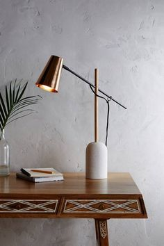 Slanted Copper Table Lamp - $448 A mix of materials and a bold shape set this Antropologie lamp apart from the rest