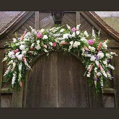 Gorgeous wreath for over a church door. Great for a wedding or Easter.