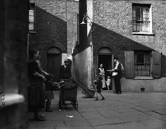A postman in Wapping, 1938.London