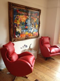 A Pair Of Contemporary Swivel Chairs In Red Leather.