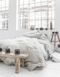 white walls / floor * wooden sidetables * grey bedding / knitted throw / knitted cushion * home * bedroom * interior * decor * style