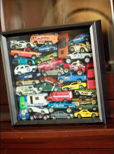 Fill a shadow box with anything that's important to your child, from toy cars to outgrown shoes.