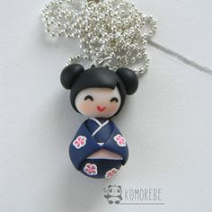 Kokeshi Doll in polymer clay Each pendant is handmade in polymer clay without the use of molds. The chain of the necklace is nickel free. Pendant size: about 3,5 cm Chain lenght: 70cm Colour of the chain: silver ------------------------------------------------------- All polymer clay