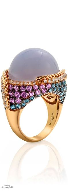 A radiant rainbow of diamonds, rubies, sapphires, emeralds and tsavorites adorn the contours of this new cocktail ring, from Fabergé Hello Color!!! Faberge's New Emotions line is full of vibrant color, who wouldn't want this gem of a cocktail ring on their finger?