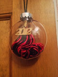 Instead of leaving it in the closet and never looking at it, put your tassel from graduation inside a Christmas ornament and hang it on the tree!