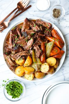 Slow Cooker Pot Roast Recipe - Damn Delicious