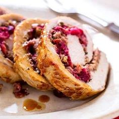 Whip up this Cranberry-Rosemary Stuffed Pork Loin for a festive Christmas dinner or stunning holiday party addition.