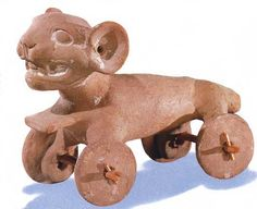 Olmec roller toy, ceramic--I love ancient toys--like this beast on wheels and little Egyptian animal toys in mummy cases