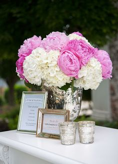 How beautiful is this floral arrangement with hot pink peonies and white hydrangeas?