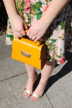 structured lemon yellow handbag + gorgeous floral fit and flare dress