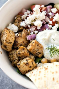 Mixed greens are topped with Greek chicken, chickpeas, tomato cucumber salad, feta cheese, and a homemade tzatziki sauce. Lime Recipes, Greek Recipes, Meat Recipes, Crockpot Recipes, Chicken Recipes, Cooking Recipes, Healthy Recipes, Dinner Recipes, Homemade Tzatziki Sauce
