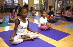 A typical primary-school-aged kids yoga class begins with them tuning inwards. They learn to notice how their body is feeling, the state of their mind, and what their breath is doing. This tuning in builds body awareness and creates a positive habit. They then warm up the muscles and link the breath with movement. #kidsyoga