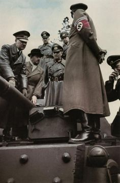 Hitler inspecting a Panzer tank: Adolf Hitler, Ferdinand Porsche, Walter Buhle and Albert Speer inspecting weaponry on March 18 or 19, 1943 in Rügenwalde in Pommern.