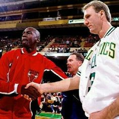 Team captains the GOAT and Larry Bird shake hands before doing battle in Boston.