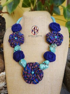 Necklace made in Guatemala, flowers with ethnic Guatemalan fabric by Astrid Botto.