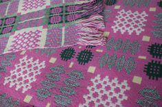 A bright and sunny pink and yellow Welsh tapestry blanket.