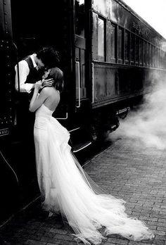 Tender embrace on train... not a bad photo idea, albeit cliche.