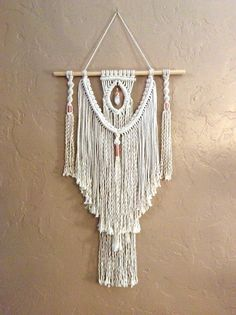 I created this beautiful Macrame Wall Hanging to be simple yet beautiful. A copper topped crystal hangs in the middle and copper beads enhances this very boho look. You have a choice of three different sizes and crystals. You may choose from clear quartz, citrine quartz and cluster crystals. See picture 4. For the large macrame, you can choose from a large 2 1/2 - 3 clear crystal quartz or amethyst. See picture 5. These are samples of the crystal you will get. Each one is beautiful and...