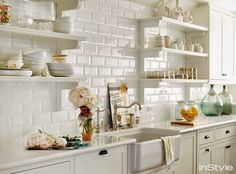 Domino shares editors' favorite celebrity kitchens from across the country to inspire kitchen design ideas in your own home. See the best celebrity kitchens belonging to Chrissy Teigen, Julia Roberts, Diane Keaton, and more. All White Kitchen, New Kitchen, Kitchen Decor, Kitchen Ideas, Kitchen Shelves, Kitchen Cabinets, Gold Kitchen, Stylish Kitchen, Kitchen Modern