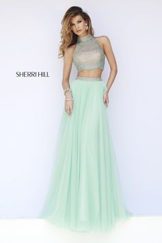 Not to sure a out the crop top skirt combo but love the color.