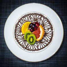 Fruits on chocolate doily