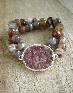 Glittering, jasper quartz druzy is adorned with multi faceted botswana agate beads along this stretch wrap bracelet. Beautiful druzy measures 1