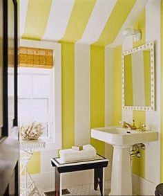 wall painting decorating with stripes, modern bathroom with yellow stripes on walls and ceiling