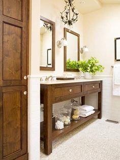 Pretty chandelier and sconces - nice with the open vanity and 2 drawers.  Like the railroad tile too.