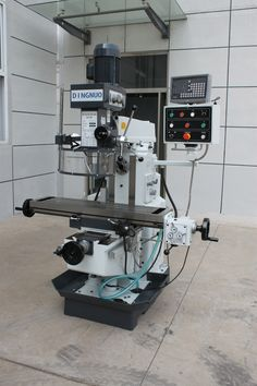 drilling milling machine is with axis is automatic feed through gear box box is gear drive, quill can feed manually. is movable forward and backward, and swivel 180 degrees. Milling Machine, Machine Tools, Johnny Bravo, Gear Drive, Lathe, Espresso Machine, Cnc, Drill, Kitchen Appliances