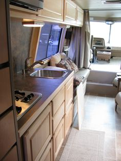 Looking forward from the bath area. The counter top extension, on this trip, will be stored between the kitchen counter and the couch cushions. There is room and it will have to do ; Motorhome Interior, Gmc Motorhome, Rv Interior, Gmc Motors, Cargo Trailer Conversion, Bus Conversion, Camping Con Glamour, Vintage Airstream, Vintage Rv