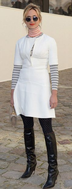 Princess Elisabeth von Thurn und Taxis, pictured at the Christian Dior show in Paris, in thigh-high black boots, a striped polo neck top and white figure-flattering dress
