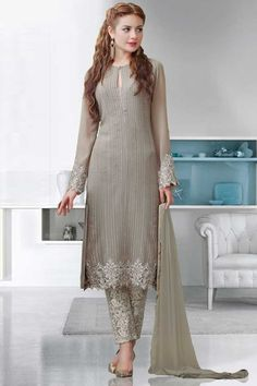 Light grey Georgette Trouser Suit With Dupatta Light grey, Georgette, semi stictch trouser suit. Allover embroidered with embroidered, resham, zari and stone work.  Round neck, Below knee length, full sleeves kameez.   Light grey, santoon trouser.   Light grey, chiffon dupatta with lace border with work.  http://www.andaazfashion.co.uk/light-grey-georgette-trouser-suit-with-dupatta-dmv13634.html