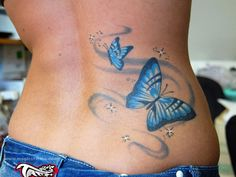 Butterfly and Dragonfly Tattoos | the blue butterfly lower back tattoo here shows two butterflies in ...