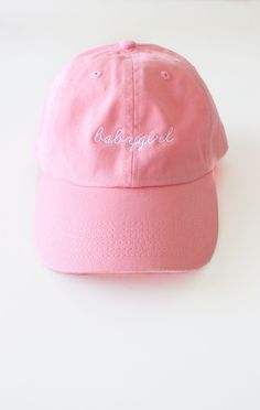 - Description Details: Six panel cap in pink with 'babygirl' embroidery & adjustable back with tri-glide buckle. Brand: NYCT Clothing. 100% Chino Twill. Imported. All accessories are final sale. Sizin