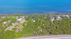 2.14 Acres with single family home & guest house on Indian River Drive $650,000 in 2017.