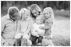 Black and white family photo all smiles with Brooke Bakken Utah Family Photographer